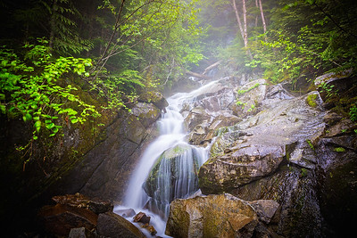 A small waterfall, shrouded in a bit of fog, that must be crossed shortly after hiking up Ira Spring Trail.