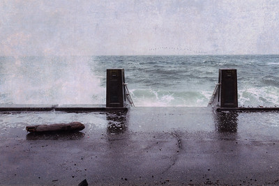 Waves crash against the wall along Alki Beach Park the morning after a snowstorm. Added a texture overlay.