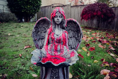 Angel covered in a fruity-colored blood sauce.