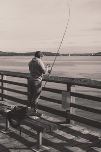 Fishing off the dock next to the Seattle Water Taxi and Marination, a popular restaurant along the Alki Trail.