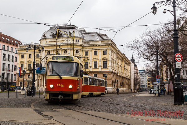 Tram pulls away from the Slovak national theatre.