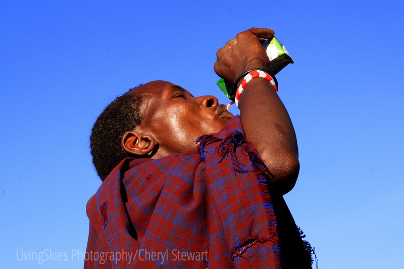 This Maasai walked upon us as we stopped for lunch, after a bit of a struggle to understand how to use a straw, he quite enjoyed the juice box.