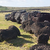 What is left of the moai Top hats lie on the ground, Ahu Tongariki
