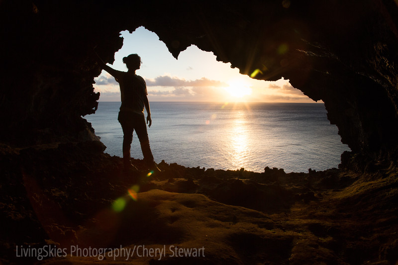 Our Rapa Nui guide poses for us in the cave end overlooking the cliffs, as the sun sets