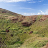 """Maunga Puna Pau  - the quarry where all the red top hats were carved out of the hillside. The stone is called red scoria, and the """"hats"""" or """"hair"""" was moved across the island to wherever the moai was erected."""