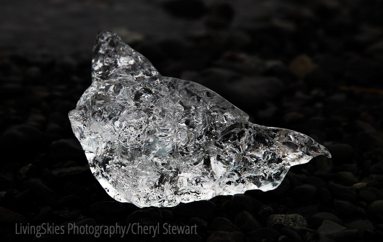 Glacial ice, on black lava sand