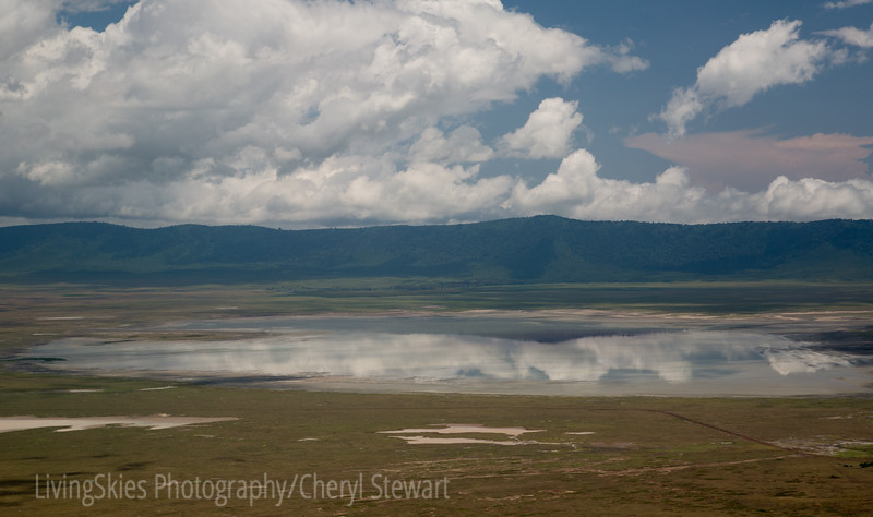Clouds reflect in lake, Ngorongoro Crater