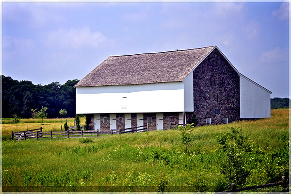 This picture was snapped while moving down the road on the tour bus.  I liked the look of the barn