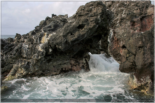 Waves would come crashing through this mini natural bridge.  It was rather fascinating to watch.