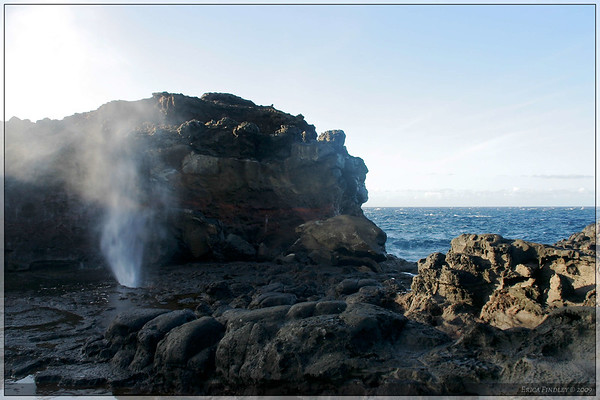 I walked down to a blow hole that was near the shore.  After helping a family take this year's Christmas Card picture, I was able to take a few shots myself.  There were times the ground would tremble before it blew.