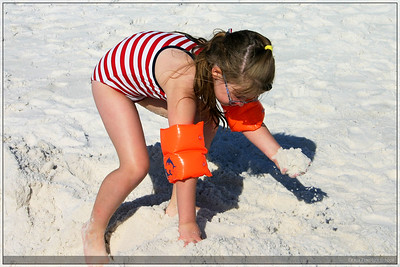 My cousin, Chloe, enjoying playing in the sand.