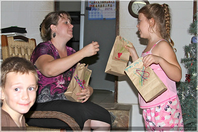 Cassie, Christal and Boaz exchanging presents.