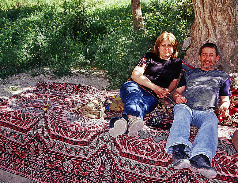 "Couple enjoying break from heat with locat drink of ""raki"". Near Cappadocia"