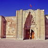 Entrance to encampment which was a resting place for travelers and their camels---where good are stored.  A Caravanserai.