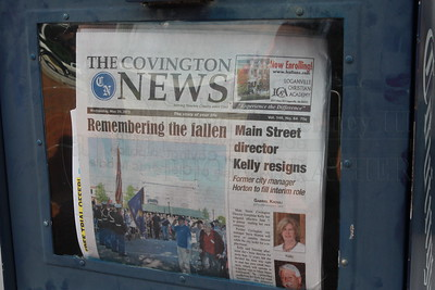 The Front Page of The Covington News as U.S. Army Private First Class Sam Walley of Winder passes the news stand on his way home. Photography By Lloyd R. Kenney III © 2013, All Rights Reserved