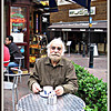 Cafe Patron, London <br /> While having breakfast one morning at a cafe in London, I was absolutely mesmerized by the man at the next table.  I simply HAD to take his photo.  I asked him if I could photograph him, he smiled and posed and went back to his coffee.  Not a word was exchanged.  I've never been so drawn to a face in my life, and still think about this rather strange encounter.
