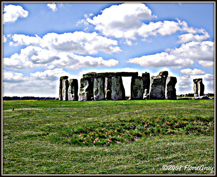 "Mystical Morn; Stonehenge  <b>Not to be reproduced without the written permission of Florence T. Gray</b>   Archaeologists Tim Darvill and Geoffrey Wainwright presented the conclusions they reached during the latest extensive investigation of the Stonehenge site conducted this past spring. Along with discovering new evidence, the scientists were able to confirm their hypothesis that the site was used as a prehistoric ""healing center.""   The most stunning of the new insights into Stonehenge is the dating and significance of the 'blue stones', which were found to have been brought to the area from West Wales in 2,300 B.C., 300 years later than scientists previously suspected. According to Professor Darvil, 60% of the blue stones were missing pieces, while only between five and ten percent of the larger stones appeared to be missing pieces. This led the scientists to conclude that the blue stones were used as talismans or lucky charms, just as the bones of saints are used as relics in healing and the designation of sacred spaces.   ""In the case of Stonehenge, the [larger iconic] stones were the church building around the magical blue stones,"" he said."
