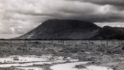 Nui Ba Den, Black Virgin Mountain. This mt was infested with Communist bunkers and tunnel systems, literally honeycombed. And after hundreds of B-52 raids and patrols on it, it still is! It's 42 miles north of Cu Chi, 3,000 feet high, and the only landmark I can see