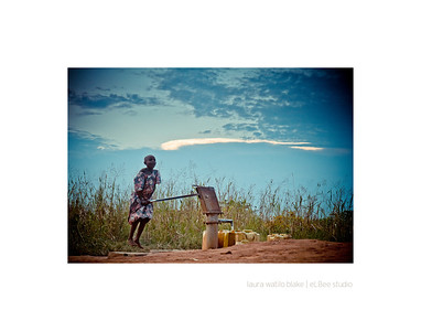 JUMP 'N' PUMP The task of collecting water is given to the children of the village, many of whom have a hard time operating the lever that brings the water to the surface.