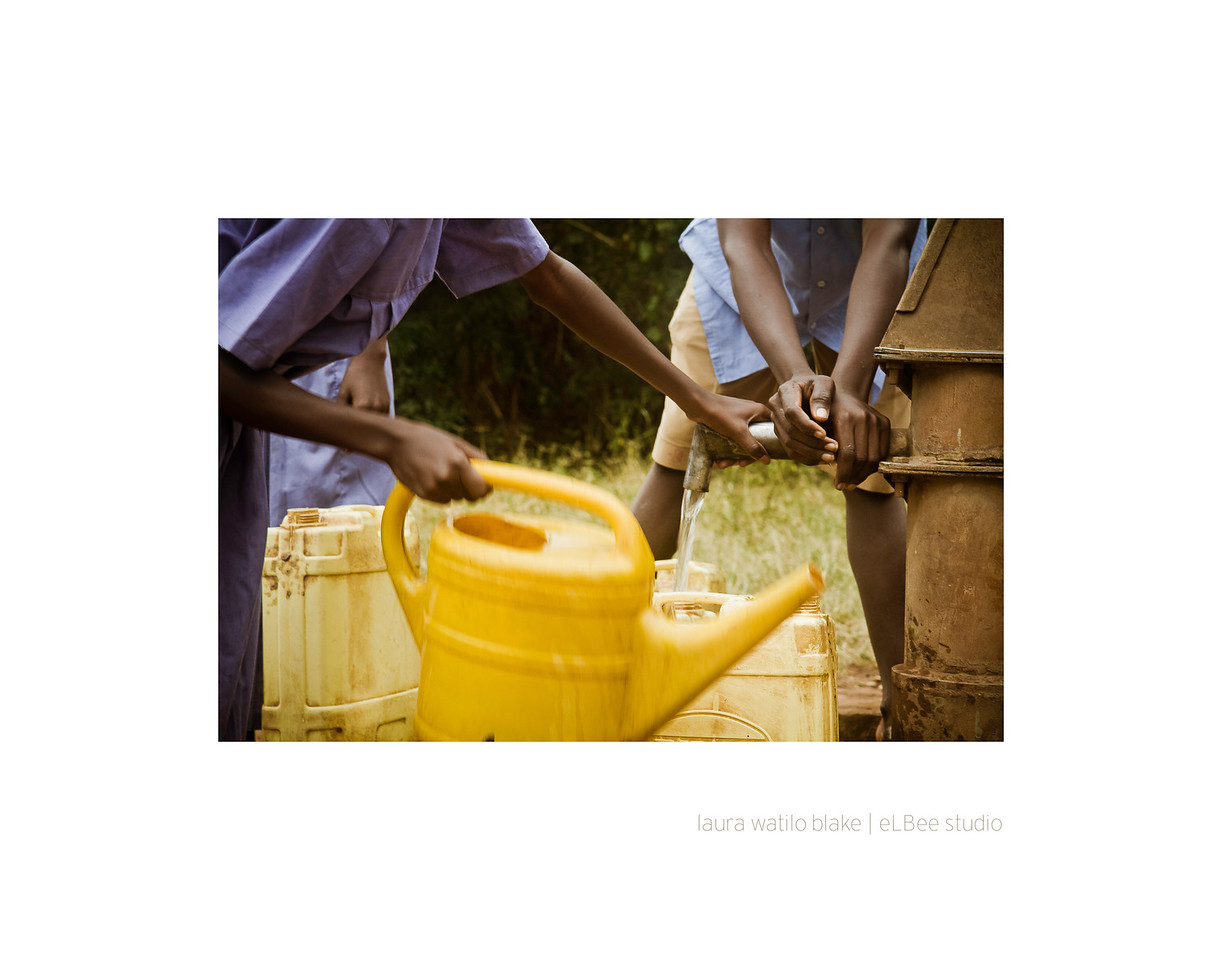 HANDS ON Kids fill their jerry cans with water from the nearest borehole, which is a mile away from the school grounds.