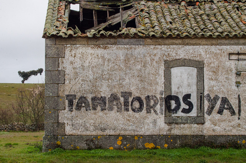 """A graffiti in Retortillo reads """"Funeral homes now! The mine is near."""" In the picture, """"Funeral homes now!"""""""