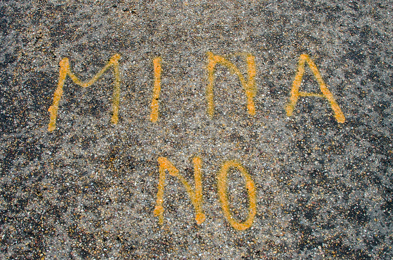 """""""No mine"""", spray-painted on the road next to Berkeley's Energia offices in Retortillo."""