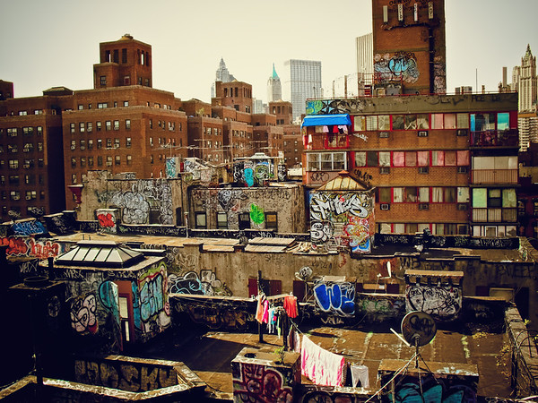 <h2>Chinatown Rooftop Graffiti - New York City</h2> - By Vivienne Gucwa  New York City is an urban layer cake.   This is another one of my favorite views in lower Manhattan. It's a small segment of an entire universe that exists above millions of New Yorkers.   Layers of colorful graffiti cover the rooftops of these Chinatown apartment buildings as rooftop doors blow open in the wind and colorful clothing sways on clotheslines high above the city below.  ---