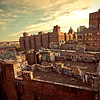 <h2>Rooftop Graffiti in Chinatown Looking Towards the Brooklyn Bridge - New York City</h2> - By Vivienne Gucwa  The sun streams across the city in the evening touching every layer of the city with its warmth.  And the streets, buildings and bridges cling to its light with soft ferocity hoping to keep it from leaving the sky.  ---