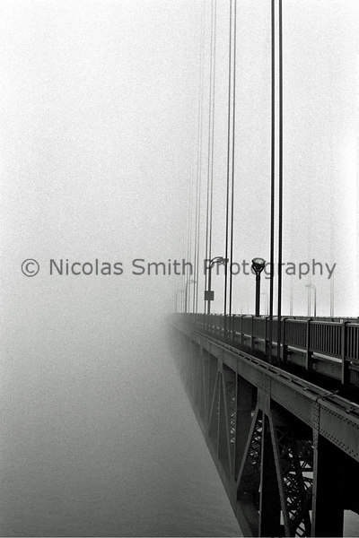 Deck & Fog, Golden Gate Bridge, 2003;  This was a typical, cold summer day at the Bridge.  Luckily, there were no pedestrians or large trucks coming across when I shot this image.  *All images and gift items print without the watermark*