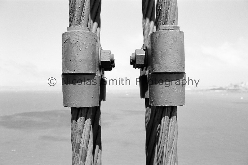 Cables and Bay: Golden Gate Bridge, 1998;  This is a detail image of the cables that support the Bridge deck.  Beyond is the City, Bay, and shadows of passing fog puffs.   *All images and gift items print without the watermark*