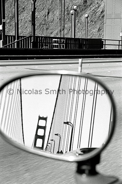 Golden Gate Rearview, 2003;  This image was a spontaneous snapshot while driving North... with one hand on the wheel, and one eye in the viewfinder.  Alternate title: Leaving San Francisco (though it seems unlikely for myself!)   *All images and gift items print without the watermark*