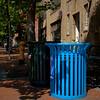 Blue recycle bin on the sidewalk in downtown Seattle