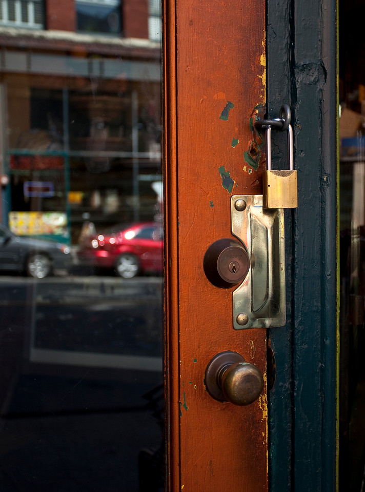 Old door with lock on a downtown seattle store front