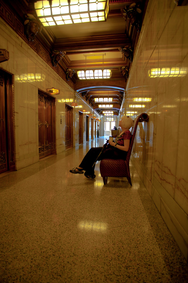 Woman waiting for the elevator inside of the Smith Tower in downtown Seattle