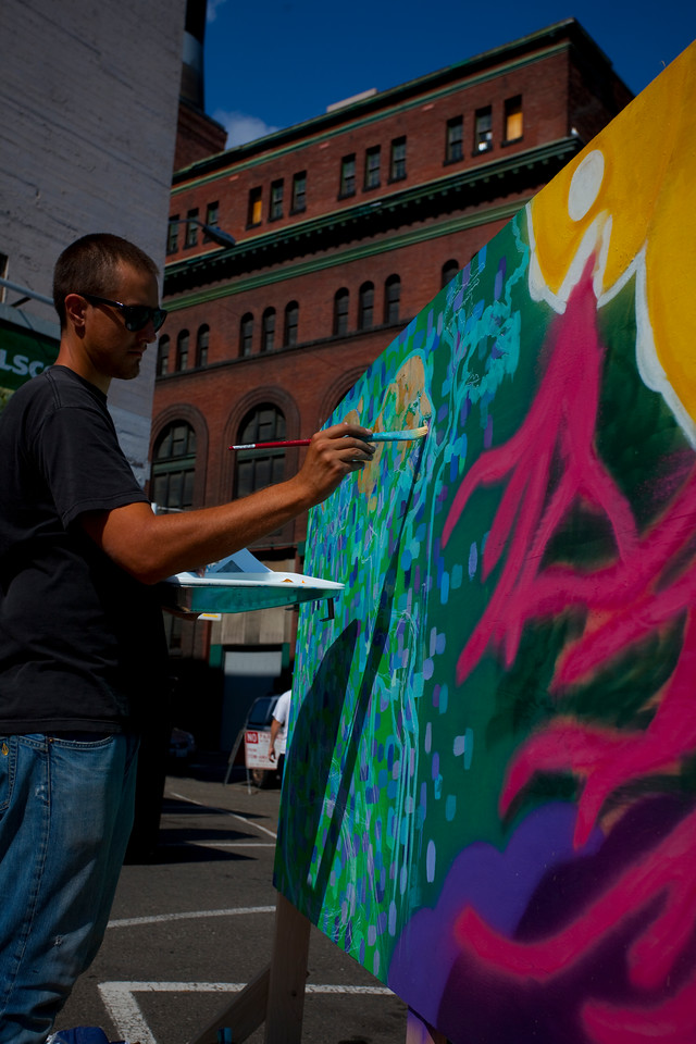 Artist working on painting during an outdoor festival in downtown Seattle