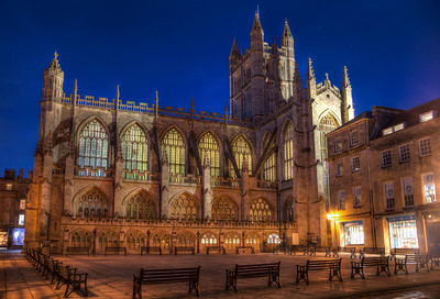 Vibrant blue sky backing up a lit up Abbey, Bath, England