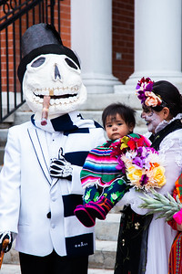 People participate in a procession to celebrate Dia de los Muertos, or Day of the Dead, on Logan Main Street on Nov. 1, 2018.  Dia de los Muertos is a Mexican holiday where families of Mexican heritage come together to honour the lives of their loved ones who have passed away and welcome the spirits back to the land of the living for the day. The holiday celebrates a belief that death is a natural part of life, and that relatives who have died are never truly gone.