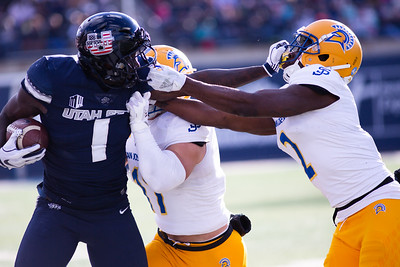 Utah State's Ron'Quavion Tarver gets tackled by San Jose Defense in the last home game of the season against San Jose State on Nov. 11, 2018 in Logan, Utah. Aggies went undefeated on their home turf with a 62-24 win against the Spartans. (Megan Nielsen)