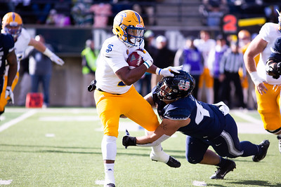 Utah State takes down a San Jose player in the last home game of the season against San Jose State on Nov. 11, 2018 in Logan, Utah. Aggies went undefeated on their home turf with a 62-24 win against the Spartans. (Megan Nielsen)