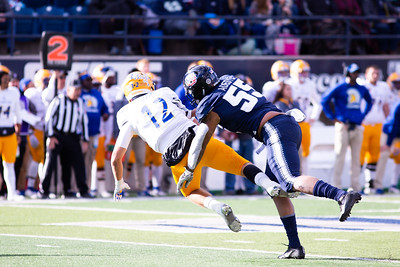Utah State's Adewale Adeoye sacks San Jose's quarterback in the last home game of the season against San Jose State on Nov. 11, 2018 in Logan, Utah. Aggies went undefeated on their home turf with a 62-24 win against the Spartans. (Megan Nielsen)