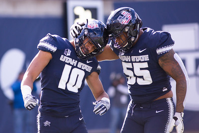 Tipa Galeai and Adewale Adeoye celebrate a good play in the last home game of the season against San Jose State on Nov. 11, 2018 in Logan, Utah. Aggies went undefeated on their home turf with a 62-24 win against the Spartans. (Megan Nielsen)