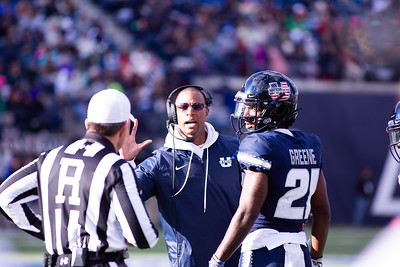 Jalen Greene and coach Jovon Bouknight on the sidelines in the last home game of the season against San Jose State on Nov. 11, 2018 in Logan, Utah. Aggies went undefeated on their home turf with a 62-24 win against the Spartans. (Megan Nielsen)