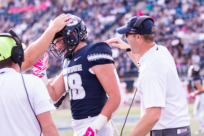 Utah State University coaches congratulate players at the football game against New Mexico in the Maverik stadium in Logan, Utah on Oct. 27, 2018. Utah State defeated the Lobos 61-19, making the Aggies season record 7 and 1. (Megan Nielsen)