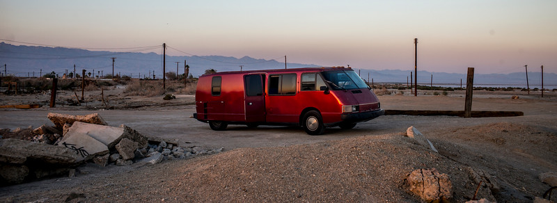 """The Vixen was a recreational vehicle designed by GM engineer Bill Collins and was built from 1986 until 1989. A total of 587 Vixen motorhomes of three different types were built: the Vixen 21 TD (1986–1987), Vixen 21 SE (1988–1989), and Vixen 21 XC (1986–1987). Ours is the 1986 TD, the 171st Vixen ever built.<br /> <br /> Often noted as the """"Driver's RV"""", or sometimes the """"De Lorean of RVs"""",  it has an exceptionally low center of gravity and wide stance for an RV. It had a top speed of 100 MPH, and claimed an average of 30 MPG using a BMW M21 turbo-diesel engine. Wind tunnel testing was used to create a completely smooth fiberglass exterior top and bottom, resulting in a drag coefficient of less than .30 for early TD models.<br /> <br /> Despite its small size by motorhome standards, the Vixen was marketed as having all of the features of larger competitors. Such features included a generator and water heater. Two house batteries and one of the first electric inverters in an RV allowed the owner to run the microwave, air-conditioning, and anything else which could be plugged into 110-volt outlets, off the batteries that were charged by the 120-amp alternator. The Vixen could also be plugged-in at a typical campsite outlet. Water came from the fresh water tank or services at a campsite and was heated by a heat exchanger. The same engine heat was used to warm the passenger compartment. Since diesels do not develop waste heat quickly, there was also an auxiliary diesel heater that could raise the temperature of the engine coolant. This helped with winter starting, keeping the RV warm, and the water hot. The heater was fuel efficient, and didn't need to stop for propane to fuel it.<br /> <br /> When you got to your destination the fiberglass roof hinged up on one side and fold-out windows filled the gap, allowing a 6'2"""" individual to stand fully and walk around. A curtain in the bath attached to the raised roof to keep water in the shower and for privacy, with a sump to"""