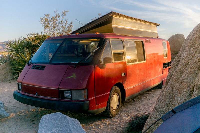 """The RV still needs a new paint job, but as you can see here, the top pops up, allowing great light and anyone up to 6' 2"""" to walk up and down comfortably without crouching."""