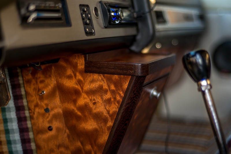 Detail of the sapele and wenge woodwork, the Missoni carpeting and the 5 speed shifter.