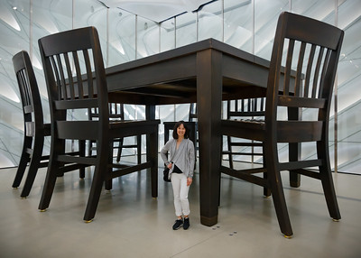 Valerie stands next to Under the Table by Robert Therrien