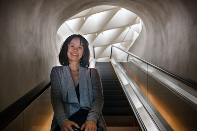 Valerie and I ride the escalator to the third-floor gallery