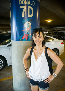 Valerie poses by the Donald so we remember where we parked  Same section as where we parked last year: https://www.akira3d.com/Photography/Friends/2018-Disneyland/i-GFbSg3n/A