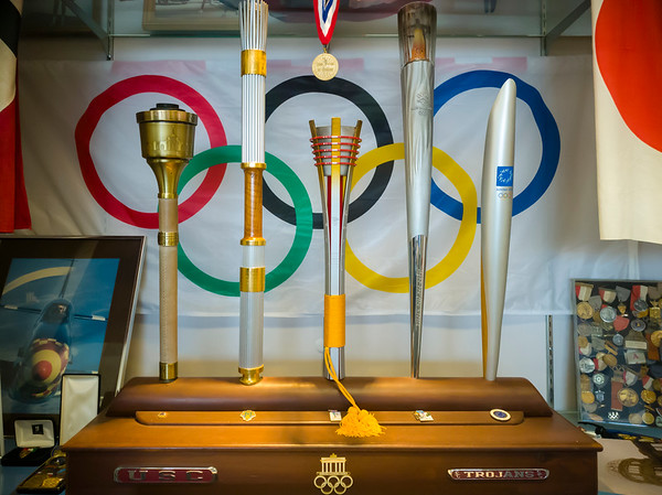 Olympic torches...I've held the one on the far left (from the one hosted in Los Angeles back in1984).  Oh yes, I forgot Zamperini was a Trojan!